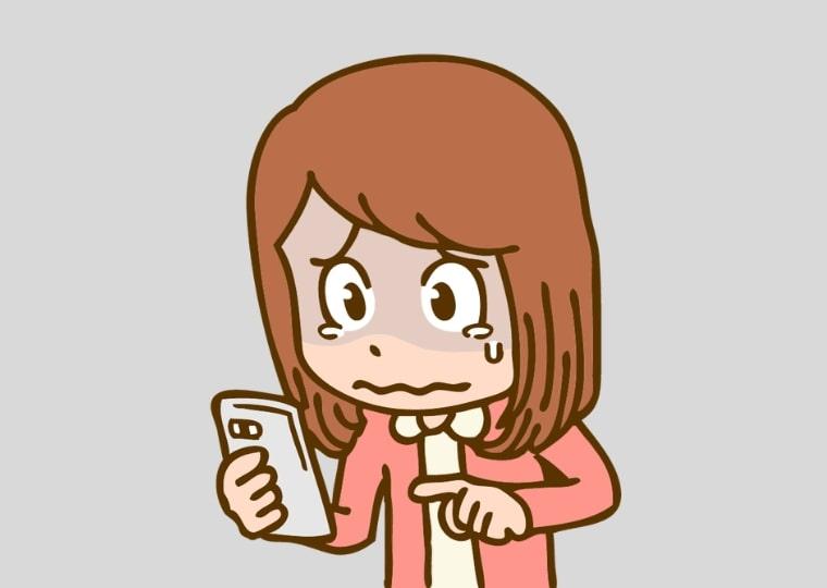 泣きながら転職サイトに登録する女性